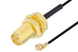 PE3CA1033 - Reverse Polarity SMA Female Bulkhead to UMCX 2.1 Plug Cable Using 0.81mm Coax, RoHS